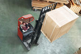 Warehouse stacker at work — Stock Photo