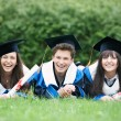 Happy graduate students - Stock Photo