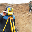 Surveyor works with total station tacheometer — Stock Photo #5743455