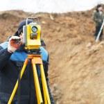 Surveyor works with total station tacheometer — Stock Photo