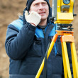 Surveyor works with theodolite tacheometer — Stock Photo #5743475