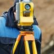 Surveyor works with theodolite tacheometer — Stock Photo #5743484