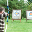 Archer aiming with bow — Stock Photo #5743500