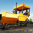 Tracked asphalt paver — Stock Photo