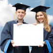 Graduate students with white board - Stockfoto