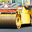 Asphalt roller compactor at work — Stock Photo