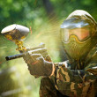 Stock Photo: Paintball player direct hit
