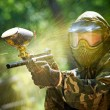 Paintball player direct hit - Stock Photo