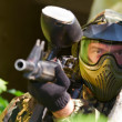 Paintball player with gun — Stock Photo