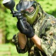 aiming paintball player — Stock Photo #5745003