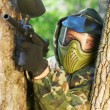 Paintball player holding position - Stockfoto