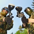 Two paintball players - Stock Photo