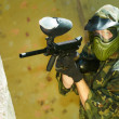 Paintball player firing -  