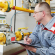 Heating engineer in boiler room - Stock Photo