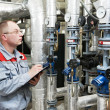 Heating engineer in boiler room — Stock Photo #5745249