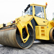 Compactor roller at asphalting work - Stock Photo