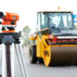 Stock Photo: Survey equipment at asphalting works