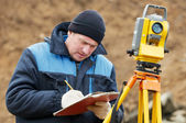 Surveyor works with total station tacheometer — Photo
