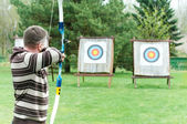 Archer aiming with bow — Stock Photo