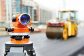 Survey equipment at asphalting works — Stockfoto