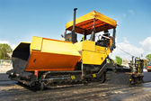 Tracked asphalt paver — Stock Photo