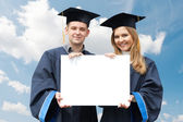 Graduate students with white board — Stock Photo