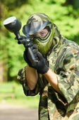 Aiming paintball player — Stock Photo