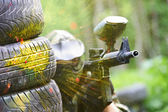 Paintball player under gunfire — Stock Photo
