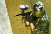 Paintball player firing — Stock Photo