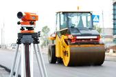 Survey equipment at asphalting works — Stock Photo