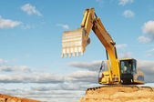 Track-type loader excavator at construction area — Stock Photo