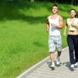 Young man and woman jogging outdoors — Stok fotoğraf #5912526
