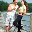 Stock Photo: Young man and woman relaxing after jogging