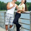 Young man and woman relaxing after jogging — Stockfoto