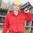 Portrait of construction worker with saw — Stock Photo #5913125