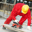 Cutting construction wood board with grinder saw — Stock Photo #5913153