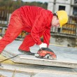 Cutting construction wood board with grinder saw — Stock Photo #5913174