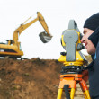 Surveyor works with theodolite tacheometer — Stock Photo #5913212