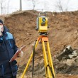 Surveyor works with theodolite tacheometer — Stock Photo #5913230
