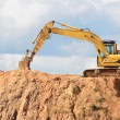 Stock Photo: Track-type loader excavator at construction area