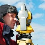 Surveyor works with theodolite tacheometer — Stock Photo