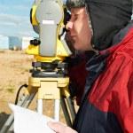 Surveyor works with theodolite tacheometer — Stock Photo #5913358