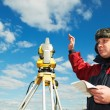Surveyor works with theodolite tacheometer — Stock Photo #5913369
