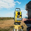 Surveyor works with theodolite tacheometer — Stock Photo #5913371