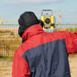 Surveyor works with theodolite tacheometer — Stock Photo #5913390