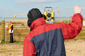 Surveyor works with theodolite tacheometer — Stock Photo