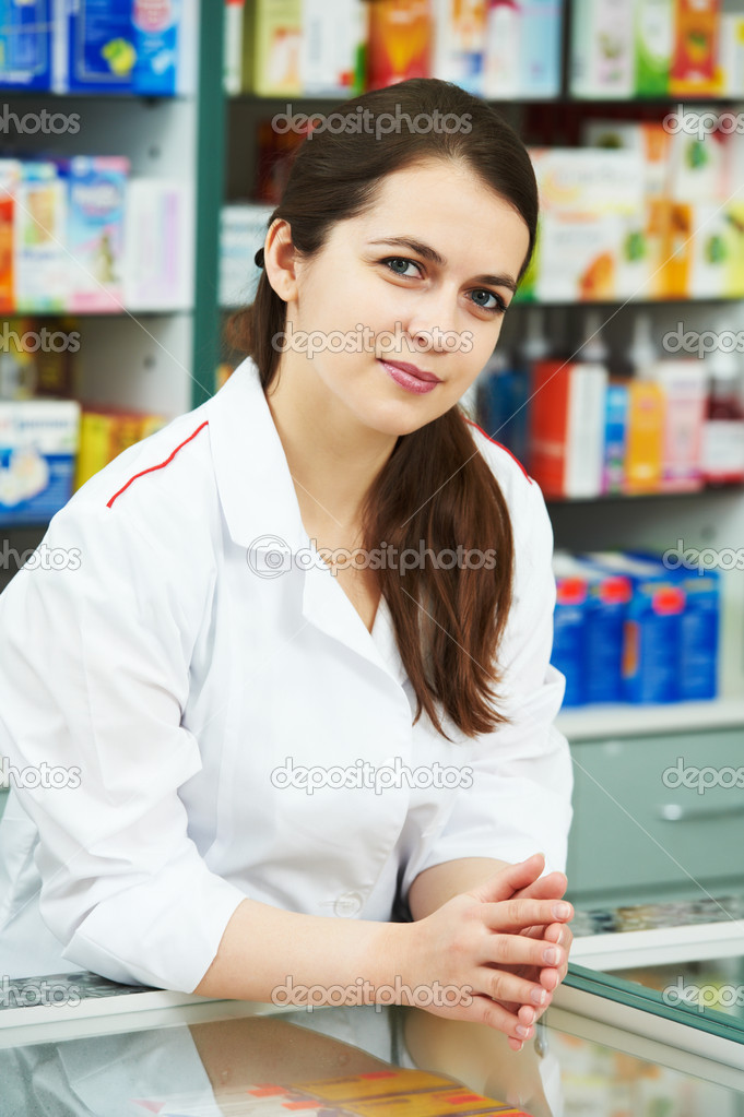 Cheerful pharmacist chemist woman standing in pharmacy drugstore — Stock Photo #5934086