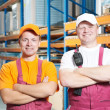 Manual workers crew in warehouse - Stock Photo