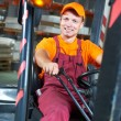 Stock Photo: Warehouse worker driver in forklift