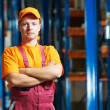 Caucasian young manual worker in warehouse — Stockfoto